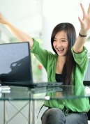 Rejoicing Girl Student at laptop